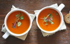 pots odf soup with herb garnishes
